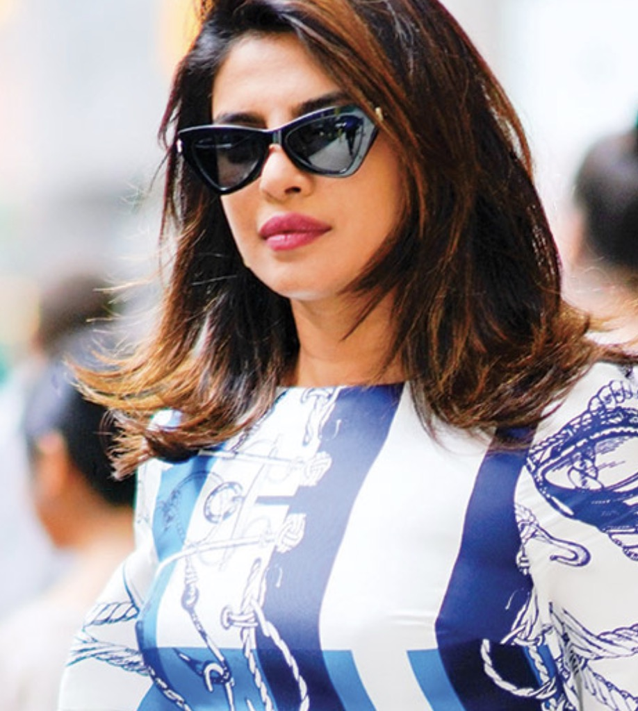 Actress Priyanka Chopra waltzes through the streets of New York City wearing Jimmy Choo Donna sunglasses